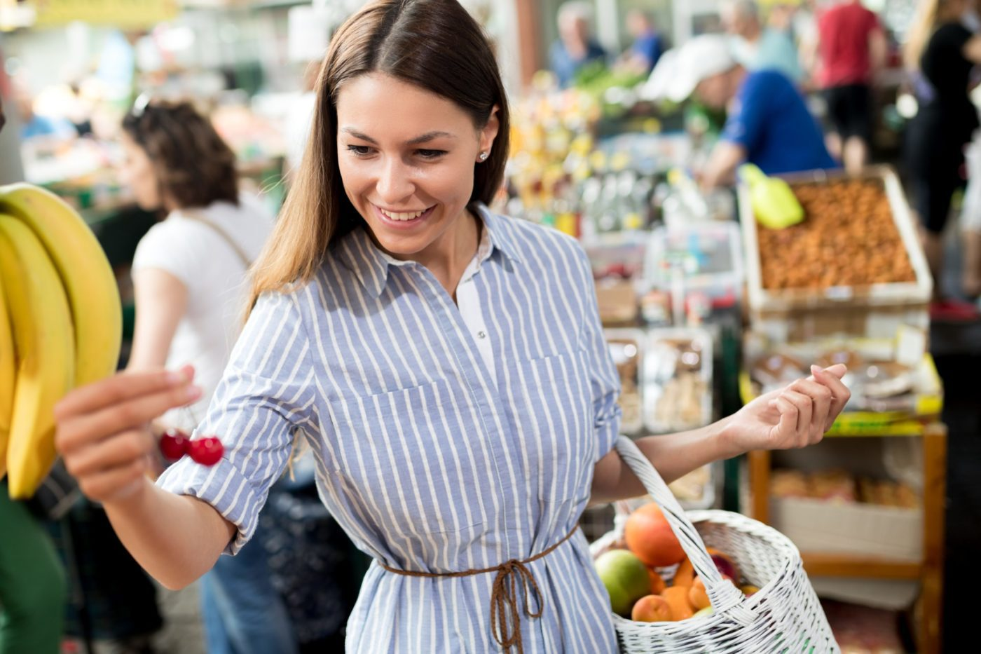 Young beautiful woman shopping on the market