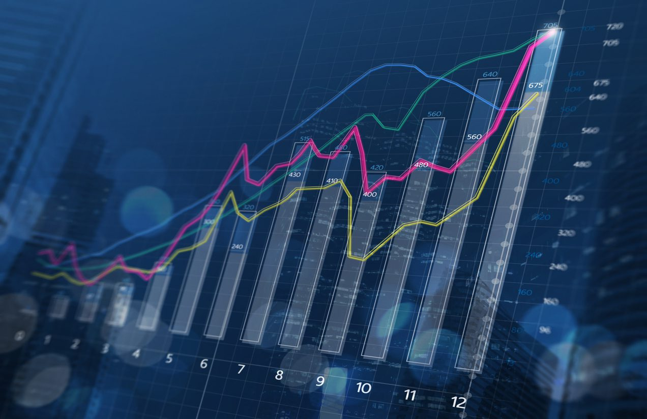 Business growth, progress or success concept. Financial bar chart and growing graphs with depth of field on dark blue background.