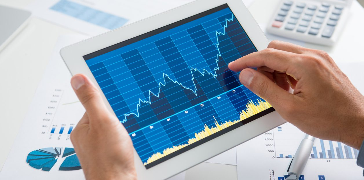 Close Up Of A Businessman Analyzing Graph On Digital Tablet
