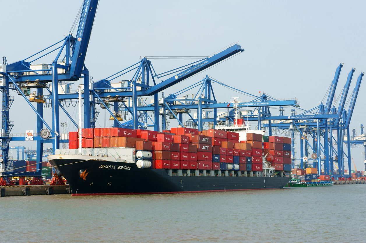 Ho Chi Minh City, Viet Nam - February 11, 2015: Transportation for export, import at Cat Lai port on Sai Gon river, crane load container to boat, this habour is big industry service for trade, Vietnam, Feb 11,2015