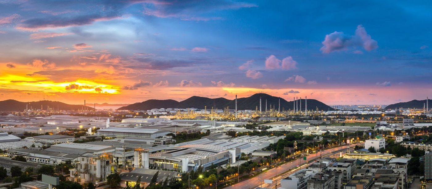 aerial view of oil refinery, pethochemical industry and warehouse in industrial area at sunset in Thailand, East of Asia, Asian