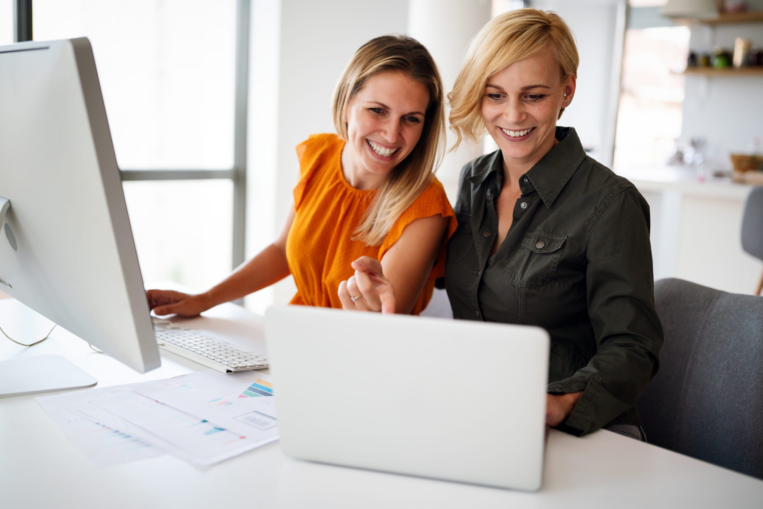 Business women working at the office on a computer. Business, teamwork, office concept.