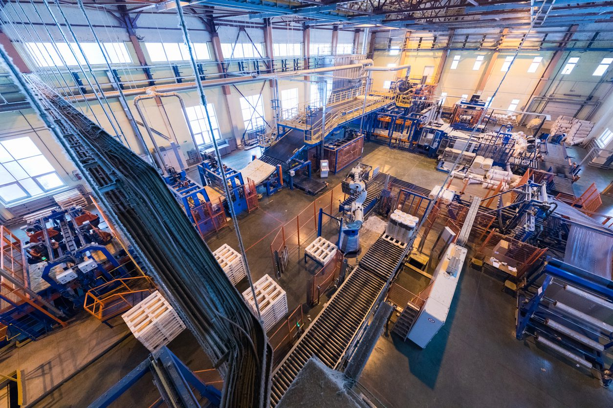 Top view of modern operational plant producing fiberglass heavy industry machinery metalworking workshop concept.