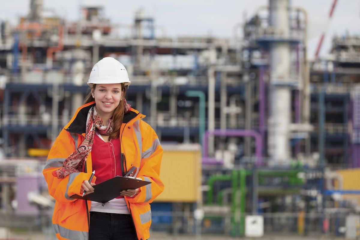 Young female industrial worker with chemical plant. [url=http://www.istockphoto.com/file_search.php?action=file&userID=1153464&text=scene72] Please click for more of this series[/url]  [url=http://www.istockphoto.com/file_search.php?action=file&userID=1153464&text=scene72][img]http://dl.dropbox.com/u/46855100/ISP%20Banners/Scene72.jpg[/img][/url]