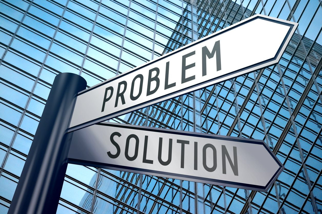 Crossroads sign with two arrows, office building - problem and solution