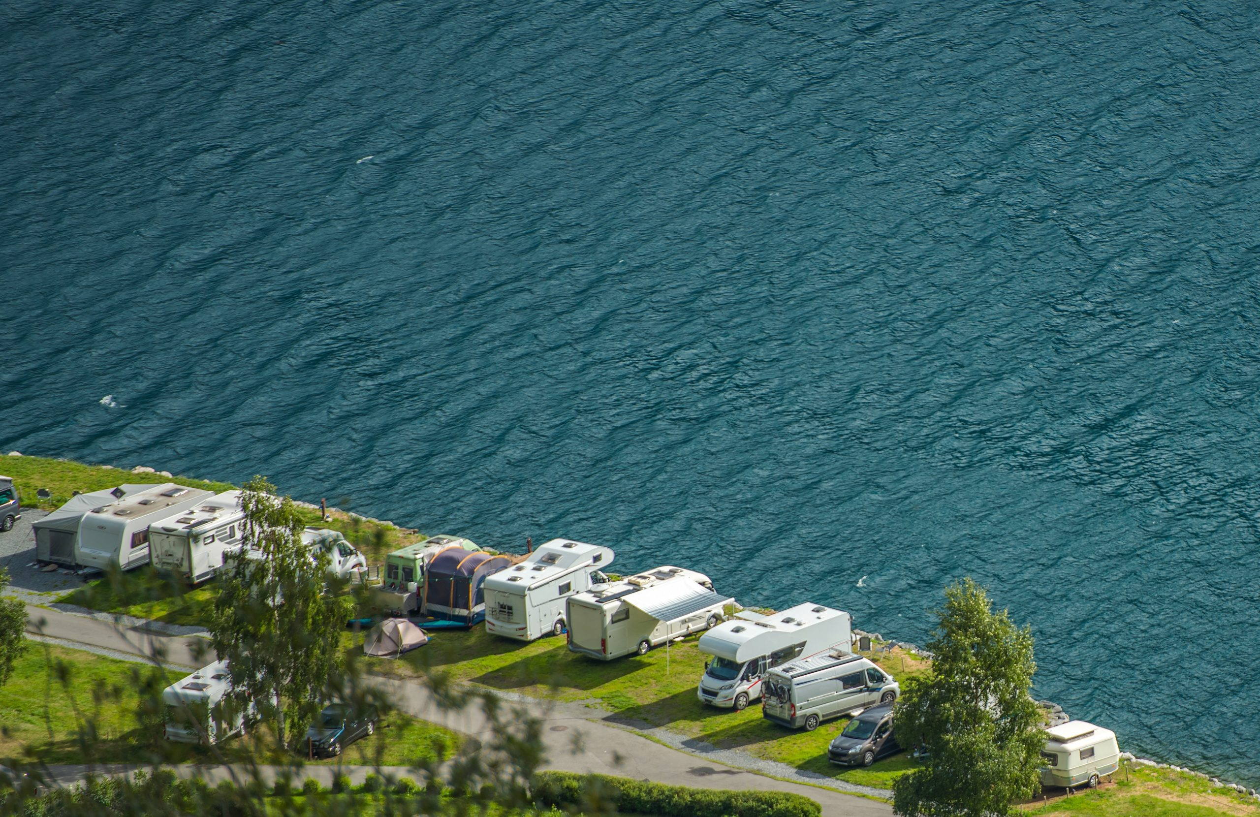 Scenic Waterfront RV Park. Recreational Vehicles Summer Camping.